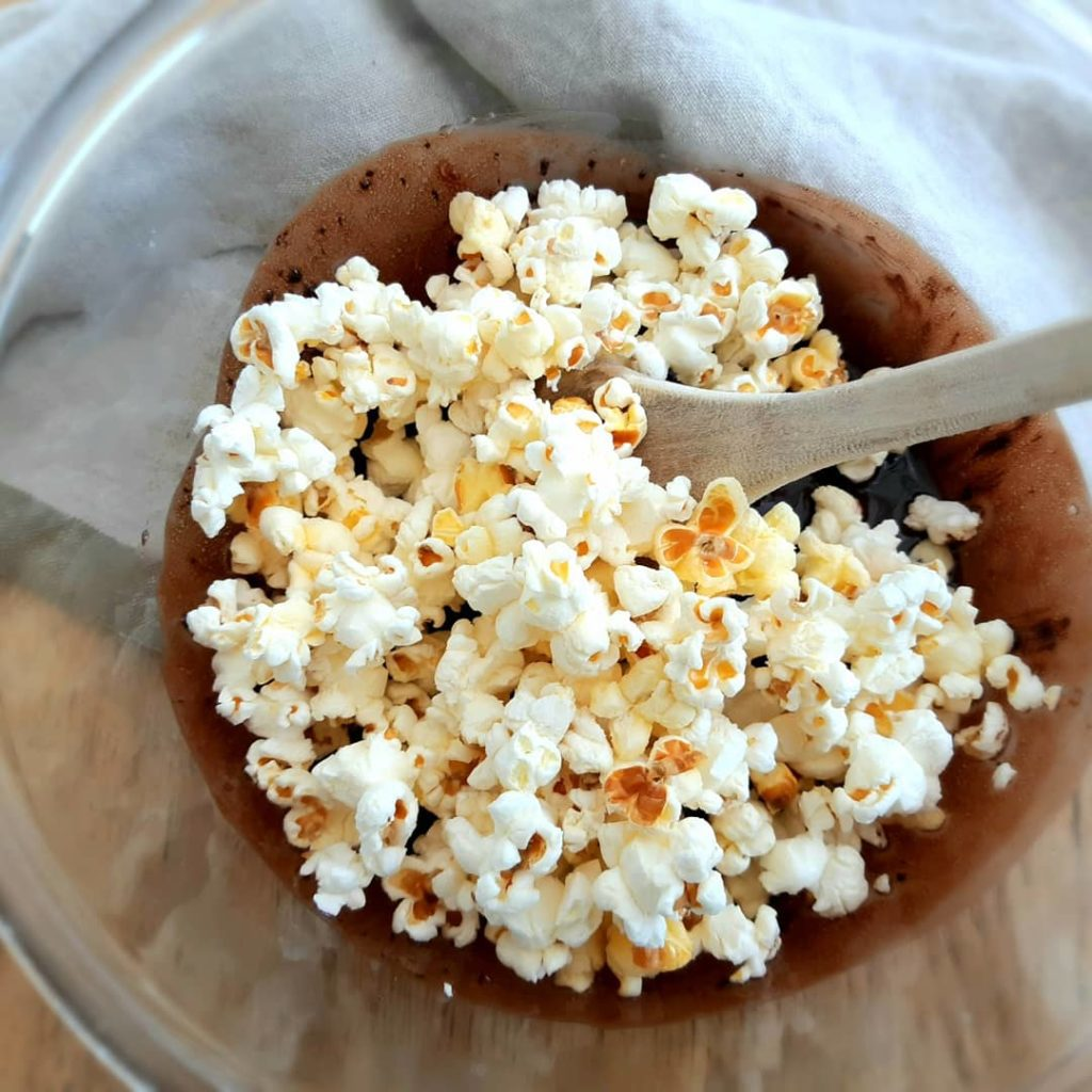 Popcorn and melted chocolate in a bowl